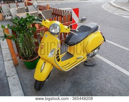 Wien, Austria - Circa September 2018: Yellow Italian Vespa Scooter Motorcycle