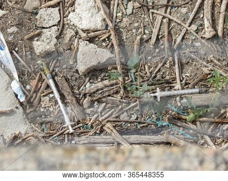 Cagliari, Italy - Circa October 2019: Heroin Needles Discarded In A Park