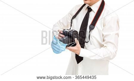 Photographer In Shirt With Tie Holds Dslr Camera With Medical Protective Mask On The Lens, Concept W