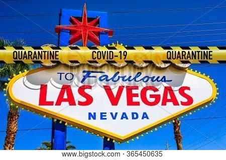 Las Vegas And Casino In Lockdown For Coronavirus. Yellow Quarantine Zone Barrier Above Welcome To Fa