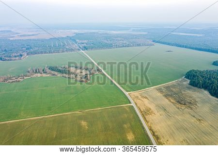 Aerial View Of Agricultural Fields With Country Roads. Panoramic Countryside Landscape In Spring Day