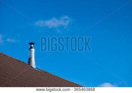 Modern Style Chimney From Oven Or Fireplace Stacked Stainless Steel On Tiled Roof Made According To