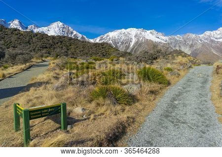 Mountain Valley Landscape With Hiking Path With Directional Sign. Hiking Directions In Mount Cook Na