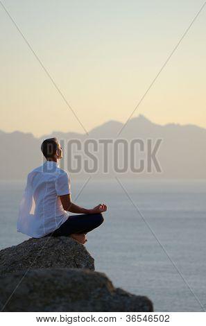 Man meditating by the sea