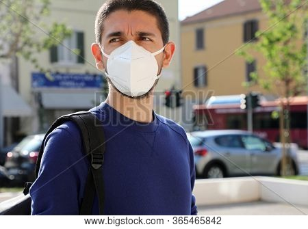 Covid-19 Pandemic Coronavirus Man In City Street Wearing Kn95 Ffp2 Face Mask Protective For Spreadin