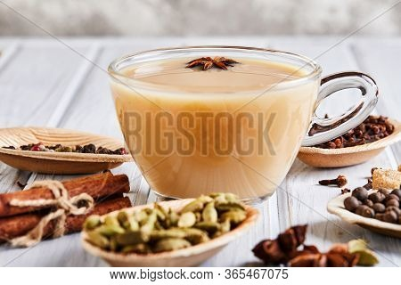 Traditional Indian Drink - Masala Tea With . Cinnamon, Cardamom, Anise, Sugar, Cloves, Pepper On A L