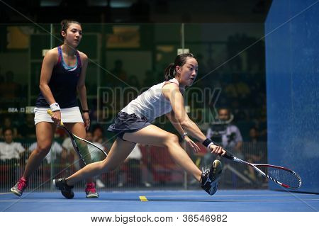 KUALA LUMPUR - SEP 02: Low Wee Wern (white top) takes on Delia Arnold in the women's finals of the Malaysian National Squash Championships 2012 played in Kuala Lumpur, Malaysia on September 02, 2012.