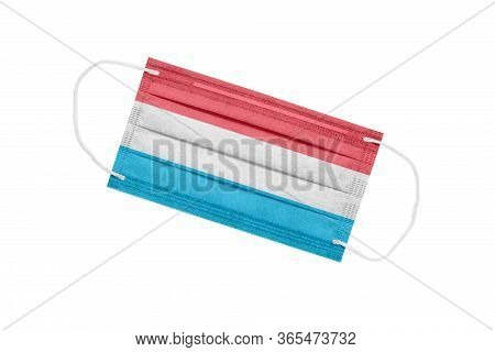 Medical Mask With Flag Of Luxembourg Isolated On A White Background. Luxembourg Pandemic Concept. At