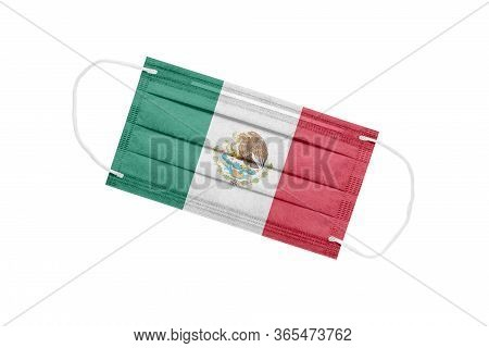 Medical Mask With Flag Of Mexico Isolated On White. Mexico Pandemic Concept. Coronavirus Outbreak At