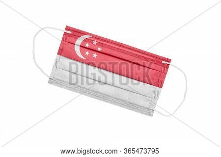 Medical Mask With Flag Of Singapore Isolated On White Background. Singapore Pandemic Concept. Corona