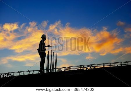 Construction Worker Using Cb Radio On A Construction Site,for Construction Teams To Work In Heavy In