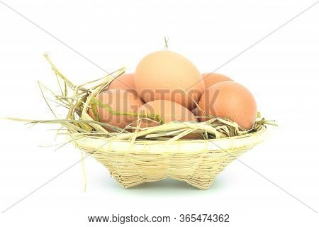 Eggs In The Basket Isolated On White Background.