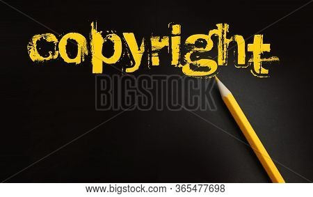 Copyright Word In Yelow On Black And Pencil Besides. Trademark Identity Owner Legal Concept