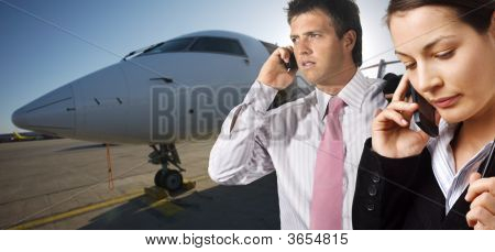 Businesspeople And Corporate Jet