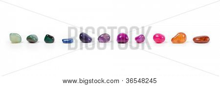 Colorful natural gem stones alighed and Isolated on white