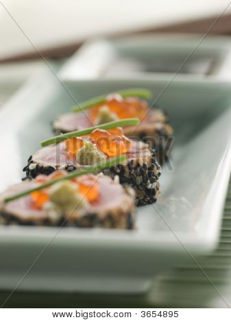 Seared Yellow Fin Tuna Rolled In Sesame Seeds With Wasabi And Salmon Roe