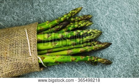 Asparagus. Fresh Green Asparagus On A Gray Slate Background, Copy Space Top View