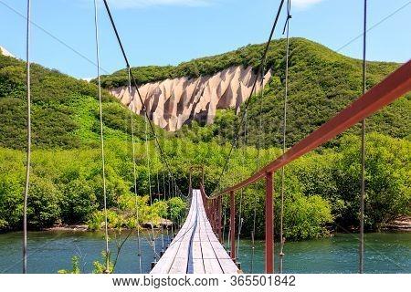 Suspension Bridge Across The River Near Kutkhins Baht, Pumice Rock Outcrops, Kronotsky Reserve, Kamc