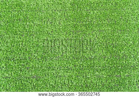 Artificial Grass Lawn Texture. Artificial Turf Background. Greenering With An Artificial Grass. Arti
