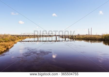 Railway Bridge Over The River. Spring View Of The Province On A Sunny Day.