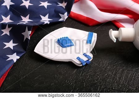 Usa Flag And Mask On A Black Background.. God Bless America. Coronavirus. National Flag Of The Unite