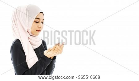 Portrait Of Beautiful Asian Muslim Woman In A Black Hijab Praying For Allah, Muslim God, Praying Han
