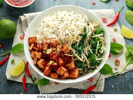 Fried Tofu In Sweet Chilli Glaze Served With Rice, Steamed Spinach And Beansprouts In White Bowl. Ve