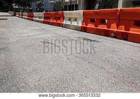 Rough Asphalt Street With Orange And White Traffic Barricade Divider, Urban City Street Scene, Creat