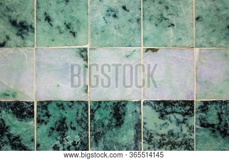 Green Jade marble stone texture, different shades of green jade tiles from Mahamuni Buddha Temple in Mandalay, Myanmar