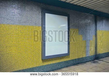 Blank Billboard On A Wall At Subway Corridor
