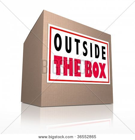The words Outside the Box on a cardboard package to represent innovation, unconventional and creative thinking in solving a problem or brainstorming