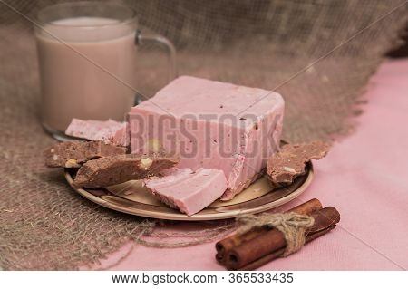 Broken Pink Ruby Chocolate Bar Pieces, Made From Ruby Cocoa Beans, Piled Up On A Miniature Cake Stan