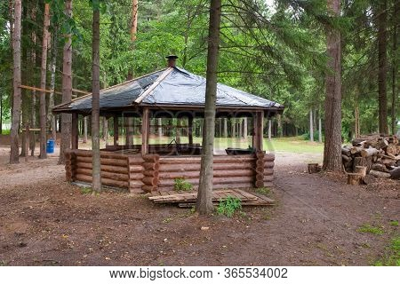 Beautiful Gazebo In The Woods Next To The Lake On An Autumn Day