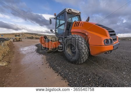 A Steamroller On A Road Construction Site