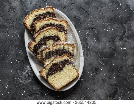 Homemade Buttery Cake With Chocolate Nut Streusel On A Dark Background, Top View. Copy Space