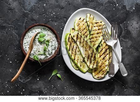 Grilled Zucchini And Tzatziki Sauce - Delicious Greek Style Snack, Tapas On A Dark Background, Top V