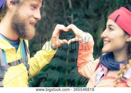 Love Couple Making Heart With Hands, Free Expression Of Love. Lovers Making A Heart-shaped Symbol On