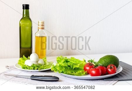Raw Healthy Food. Vegetables, Mozzarella And Olive Oil On White Background, Top View