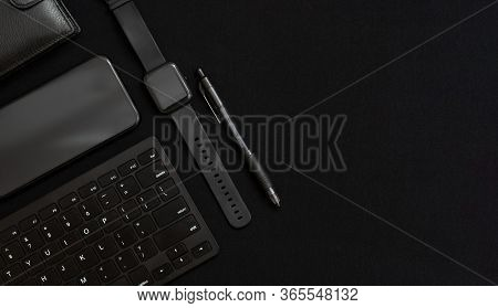 Flat Lay Composition With Black Pen, Computer Keyboard, Smart Watch, Smartphone And Leather Wallet O