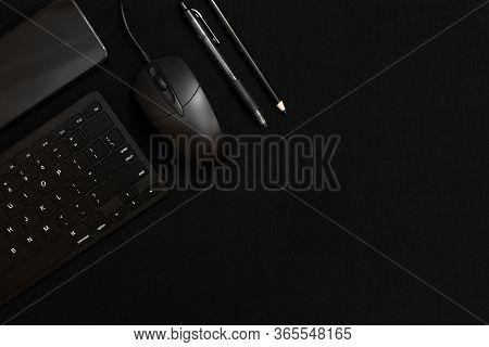 Black Smartphone, Black Keyboard, Black Pencil, Black Pen And Black Computer Mouse On A Black Backgr