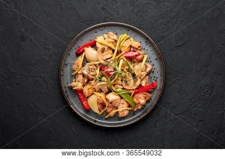Thai Ginger Chicken Or Gai Pad King In Dark Plate At Black Slate Backdrop. Gai Pad King Is Thailand