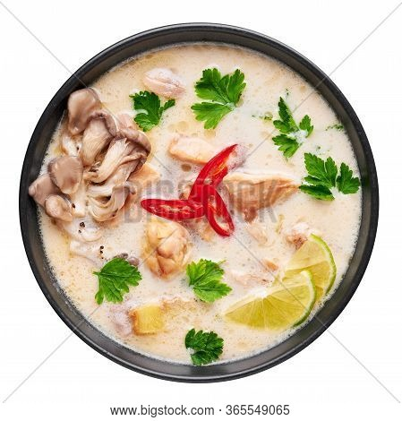 Tom Kha Gai Or Thai Coconut Chicken Soup In Black Bowl Isolated On White Backdrop. Tom Kha Gai Is Th