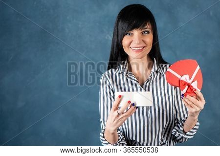 Beautiful Girl, Brunette Opens The Box As A Heart, A Gift. Valentine's Day, Hand And Heart Proposal,