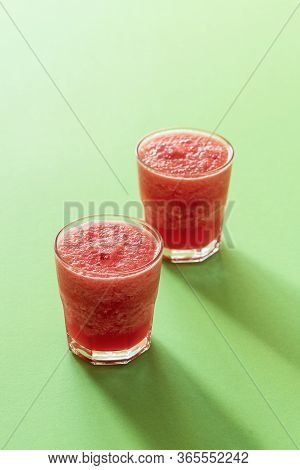 Sweet Watermelon Slush On A Green Background In Harsh Light. Two Glasses Of Watermelon Iced Drink. S