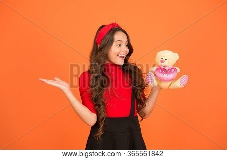 Presenting Product For Valentines Day. Happy Girl Hold Teddy Bear And Open Hand. Promoting Product.
