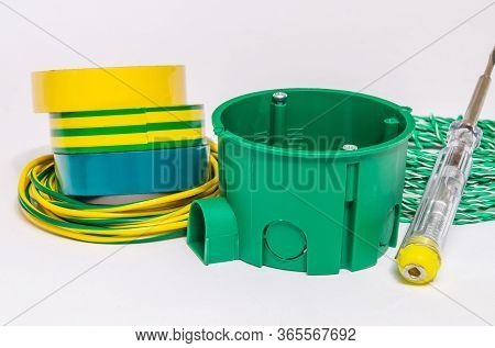 Kit Spare Parts And Tools For Electrical Repairs In Home Or Office On Gray Background