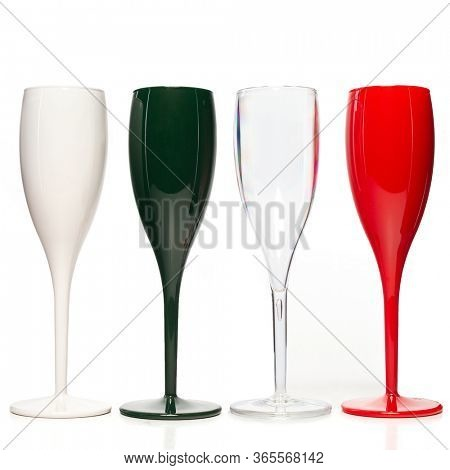 Realistic champagne glasses. Four mulricolored champagne glasses  for gourmets. Isolated glass cup on wite background for festive events