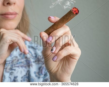 A Woman With A Large Cuban Cigar. Cuban Cigars Concept.