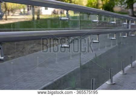 Dirty Glass Railing With Chrome Railing At The Entrance To The Building. Modern Architectural Fence