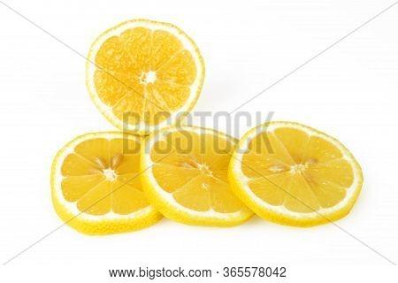 Sliced Lemon Round Slices, White Background, Macro